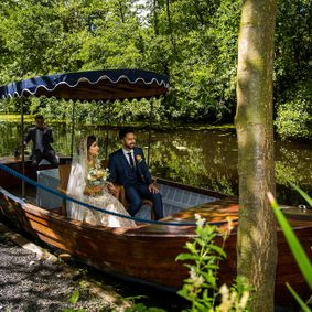Asian Wedding Cinematography of bride and groom at a lakeside marque | Thornton Manor