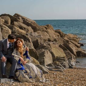 Asian Wedding Photography of bride and groom outside Leas Cliff beach