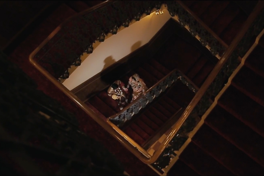 Saima & Dipan walking up the stairs at Paddington Hotel in London on their wedding day | Asian Wedding Video