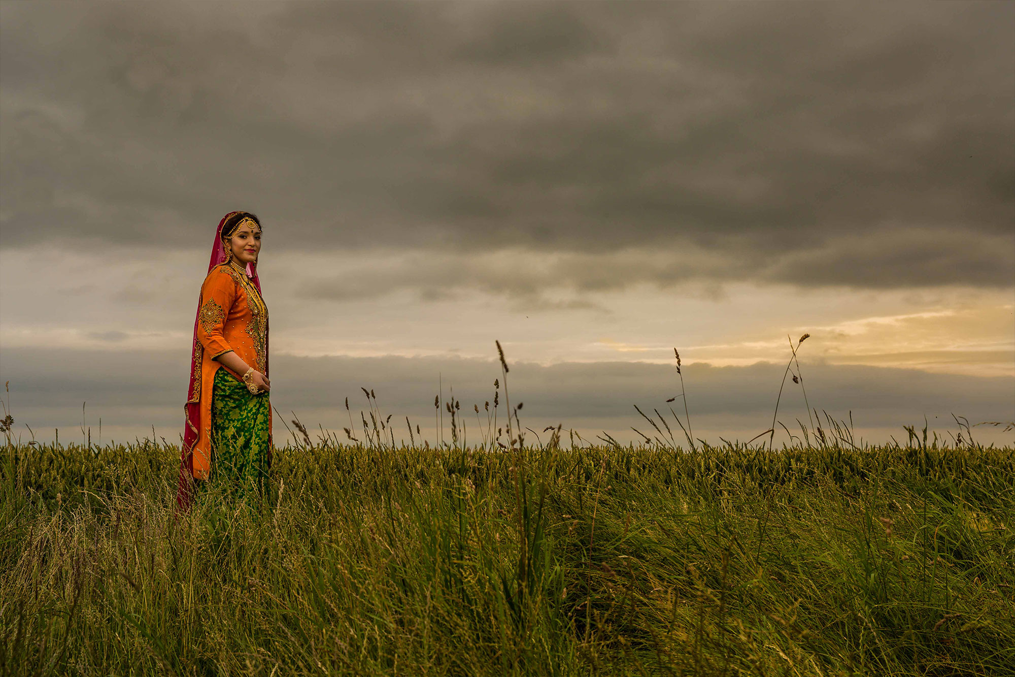 A International asian wedding image of a lovely bride in an open field