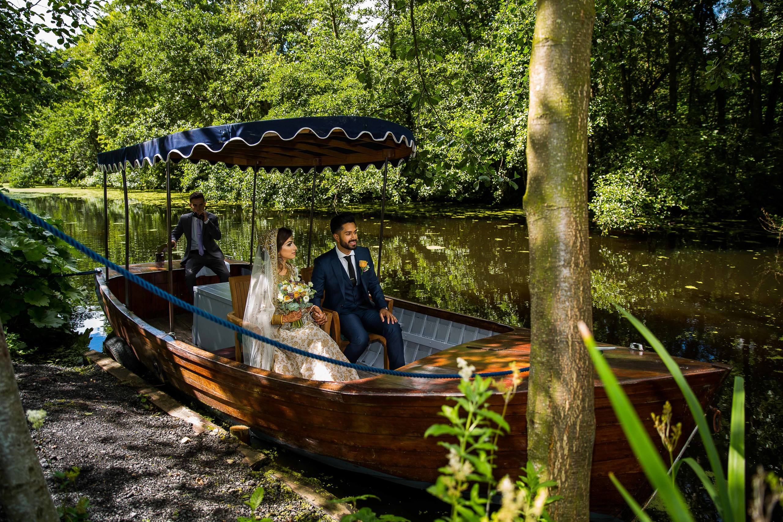 Asian Wedding couple on a boat in Thornton Manor Lake Side Marque | Asian Wedding Video